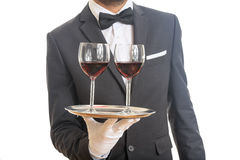 Waiter serving wine on a tray Stock Photo