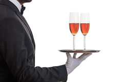 Waiter serving wine on a tray Stock Image
