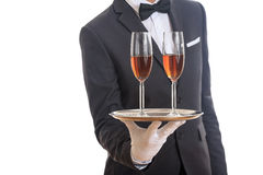 Waiter serving wine on a tray Royalty Free Stock Images