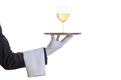 Waiter serving wine on a tray Royalty Free Stock Image