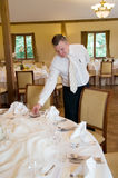 Waiter setting table Stock Photo