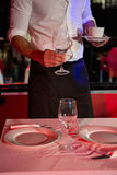 Waiter setting a table Stock Photo