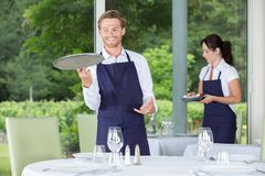 Waiter setting up table stock photography