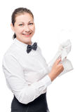 Waiter in a shirt and tie with a clean empty glass on a white. Background stock image