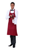 Waiter showing bottle Stock Photography