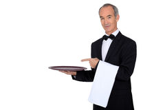 Waiter showing his tray Stock Photography