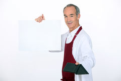 Waiter showing the menu Royalty Free Stock Photos