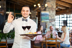 Waiter showing ok sign Royalty Free Stock Images