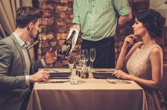 Waiter showing a sparkling wine bottle Royalty Free Stock Photography
