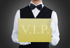 Waiter Showing Vip Text On Banner Stock Photos
