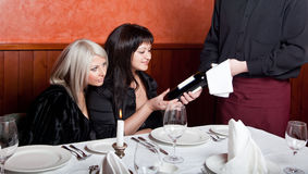 The waiter shows a bottle of wine Stock Photos
