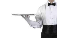Waiter with silver tray. Formal waiter holding silver tray stock photos