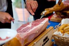 Waiter is slicing ham Stock Image