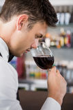 Waiter Smelling A Glass Of Wine Royalty Free Stock Images