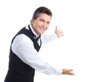 Waiter. Smiling handsome waiter. Isolated over white background Royalty Free Stock Photo
