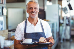 waiter smiling and holding tray Stock Images