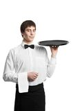 Waiter sommelier man with tray. Positive Waiter man with empty restaurant tray isolated on white Royalty Free Stock Image