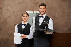 Waiter and sommelier serving wine royalty free stock images