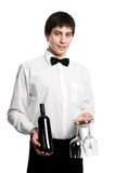 Waiter sommelier with wine bottle. Sommelier Waiter with bottle of red wine and stemware glass isolated royalty free stock photos