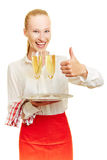 Waiter with sparkling wine holding thumb up Stock Photo