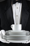 Waiter With a Stack of Plates Stock Images