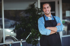 Waiter standing with arms crossed outside the cafe. Portrait of waiter standing with arms crossed outside the cafe Stock Images