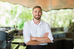 Waiter standing with arms crossed at restaurant. Portrait of waiter standing with arms crossed at restaurant Royalty Free Stock Photos