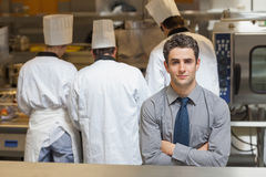 Waiter standing in the kitchen Royalty Free Stock Photos