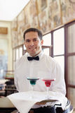 Waiter standing with tray in restaurant Royalty Free Stock Photo