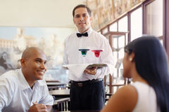 Waiter standing with tray in restaurant royalty free stock photos