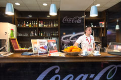 Waiter stands behind bar at Belgrade airport. Royalty Free Stock Photo
