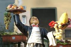 Waiter statue. At restaurant entrance stock image