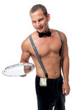 Waiter stripper with a tip. In the pants Stock Photos