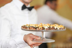 Waiter with stuffed mushrooms Royalty Free Stock Image