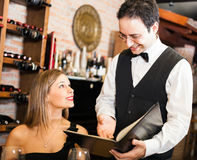 Waiter suggesting food in a restaurant Royalty Free Stock Image