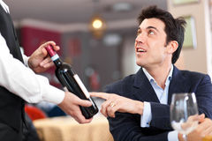 Waiter suggesting wine Stock Photos