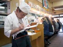 Waiter at sushi restaurant around tsukiji fish market Stock Image