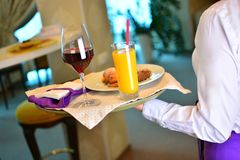 Waiter takes a breakfast to the hotel room royalty free stock photos