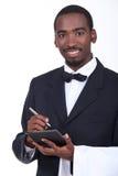 Waiter taking an order. Black waiter taking an order Stock Image