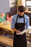 Waiter taking order in his book. In the cafe Stock Photos