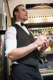Waiter taking order in his notepad. In a bar Royalty Free Stock Photography