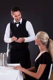 Waiter taking order. From women in restaurant Stock Images