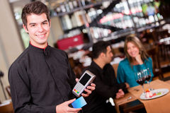 Waiter taking a payment Royalty Free Stock Photos
