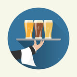 Waiter with three glasses of beer Royalty Free Stock Photo
