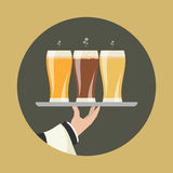 Waiter with three glasses of beer Royalty Free Stock Image