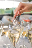 The waiter throws a blanket in wine glasses Stock Photos