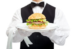 Waiter torso with hamburger on plate Royalty Free Stock Images