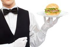 Waiter torso with hamburger on plate. Isolated on white background stock photos