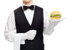 Waiter torso with hamburger on plate Stock Images