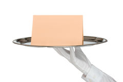 Waiter with tray. Waiter with white protective gloves holding silver tray with card - white background royalty free stock images